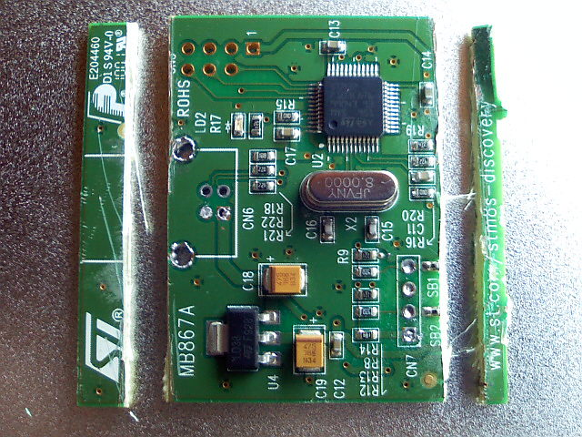 Cut two edges of STM32 part of STM8S Discovery Kit